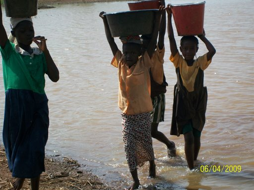 Children carrying drinking water